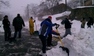 Neighbors at Vanguard Street get together and shovel their street from the top of the hill all the way to Main Street