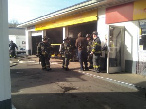 Firefighters extinguish car fire inside Boston Ave. Shell--Photo by Johnny Fresco